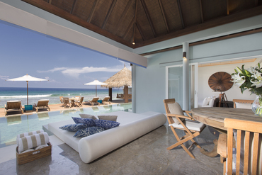 Naladhu_Residence_breezeway_pool_and_twin_bedroom